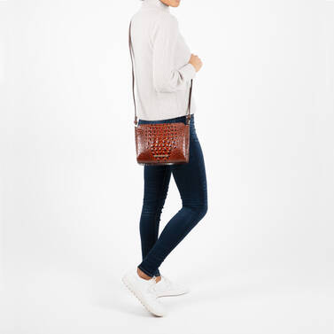 Carrie Crossbody Ember Fuego on figure for scale